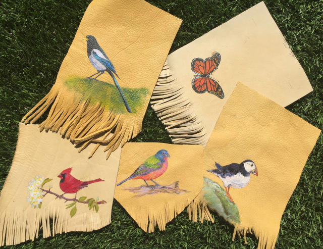 Birds and a Monarch butterfly on elk hide