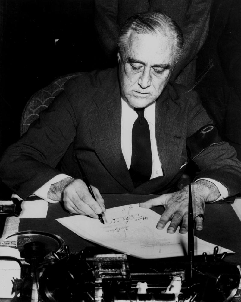 President Roosevelt signs declaration of war