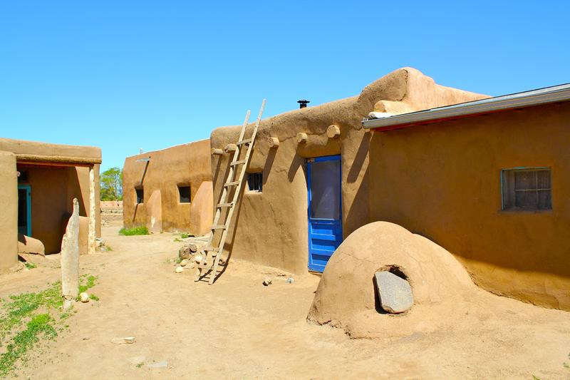 Taos Pueblo home with orno oven out front