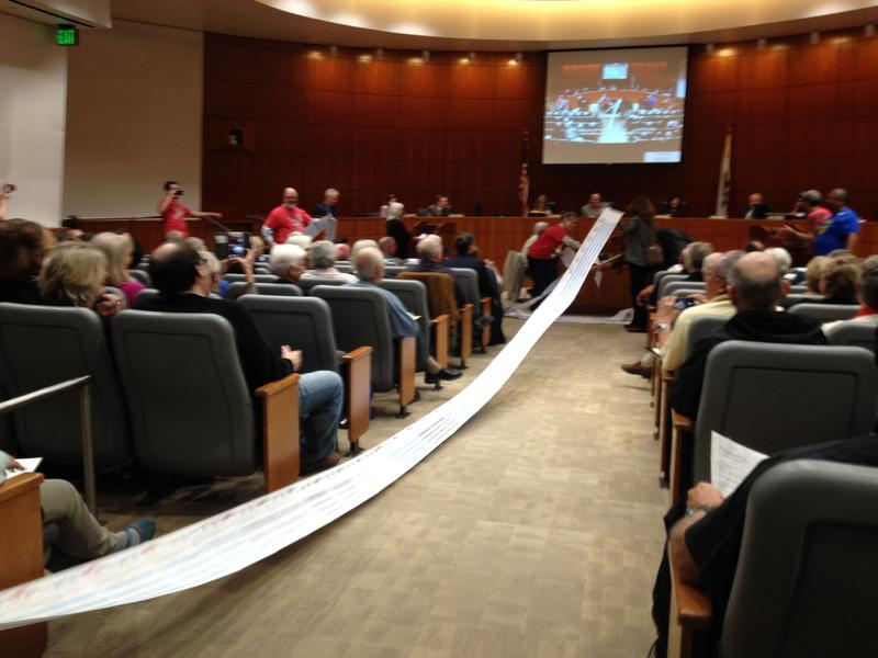 During Monday's hearing, opponents of the project unrolled a listing of thousands of signatures asking the board to reject the appeal.
