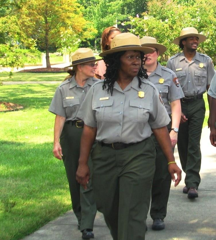Ms. Robin White NPS Superintendent Little Rock Central High with fellow park rangers