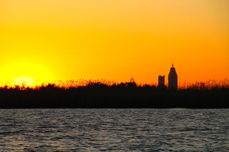 Sunset on the Delta with City of Mobile on the Horizon