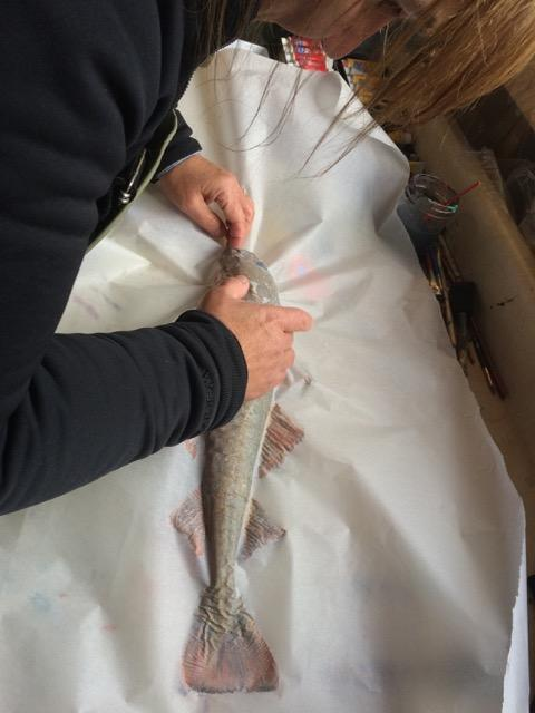 Kimberley Orren helping with Gyotaku.