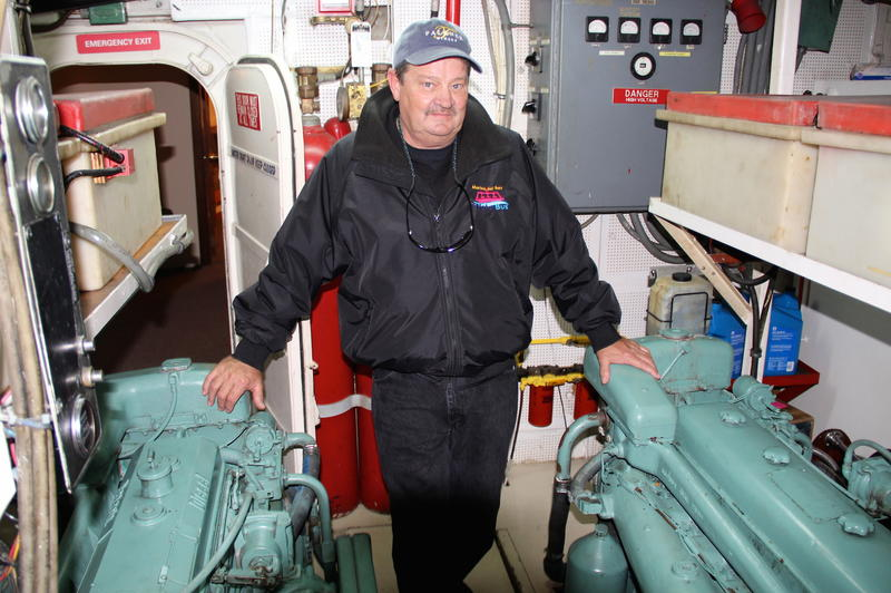 Captain Chuck Myers in the engine room of the M.V. Zumbrota
