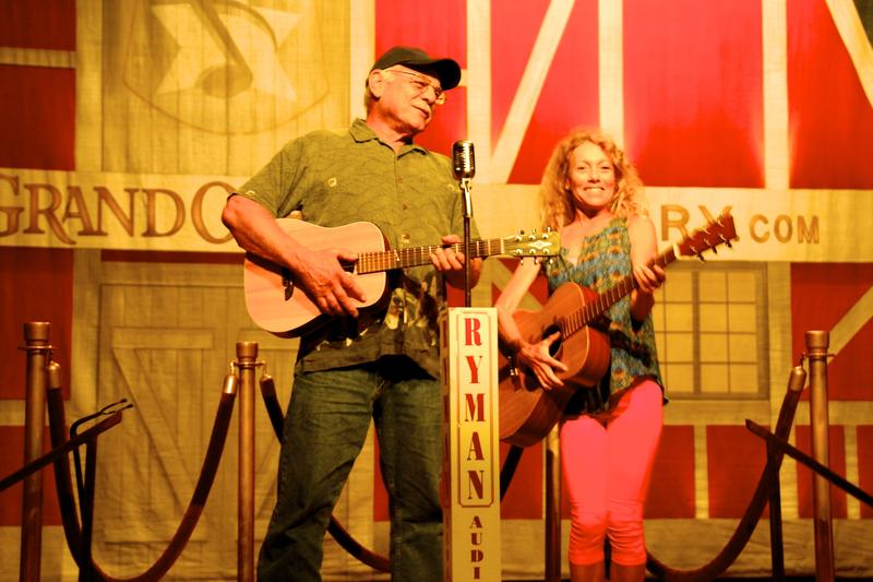Correspondent Tom Wilmer accompanies Robin Tierney onstage at the Ryman Auditorium, Nashville, Tennessee