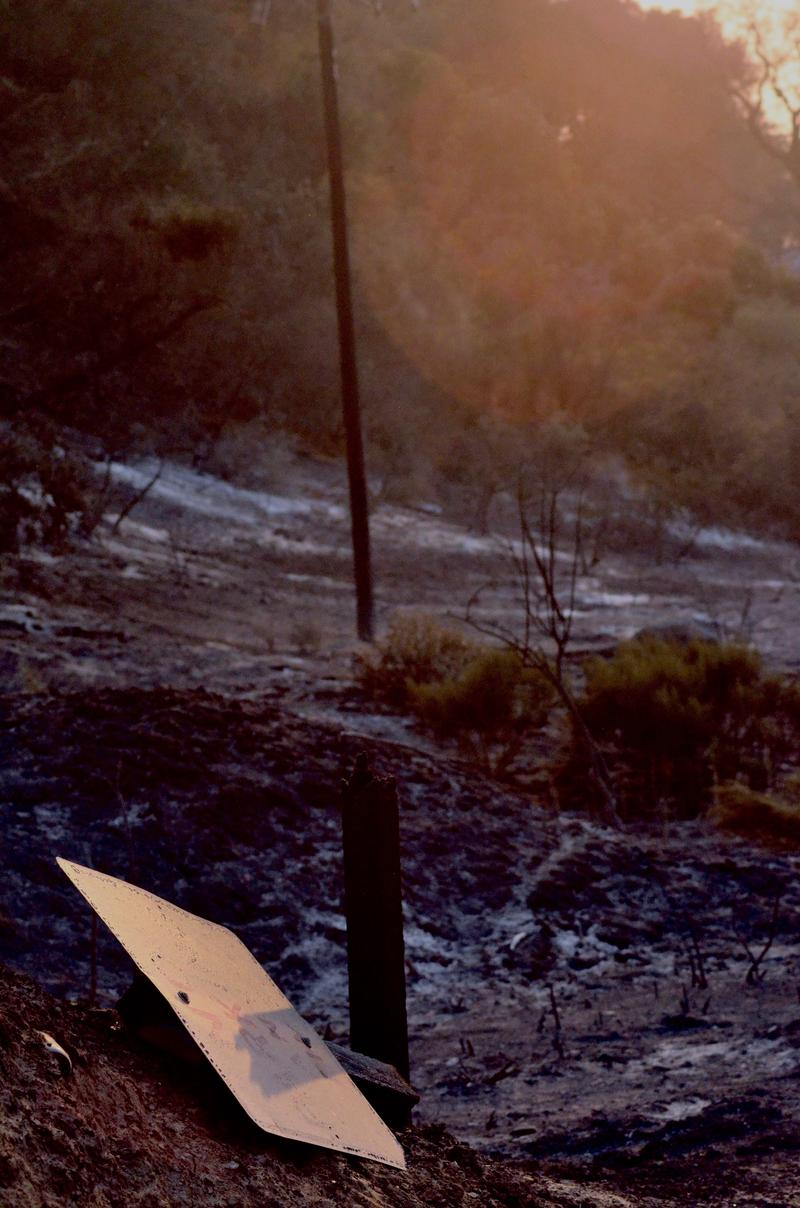 "A burnt ""no parking"" road sign, near Lake Cachuma on Sunday."