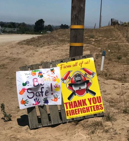 Area residents put out signs of appreciation near the Alamo Fire.