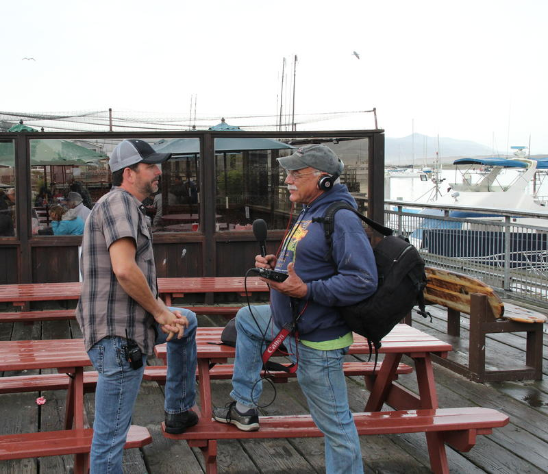 GIO Giovanni DeGarimore talks with correspondent Tom Wilmer on the docks at Morro Bay