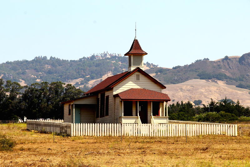 San Simeon one-room schoolhouse with Hearst Castle in distance
