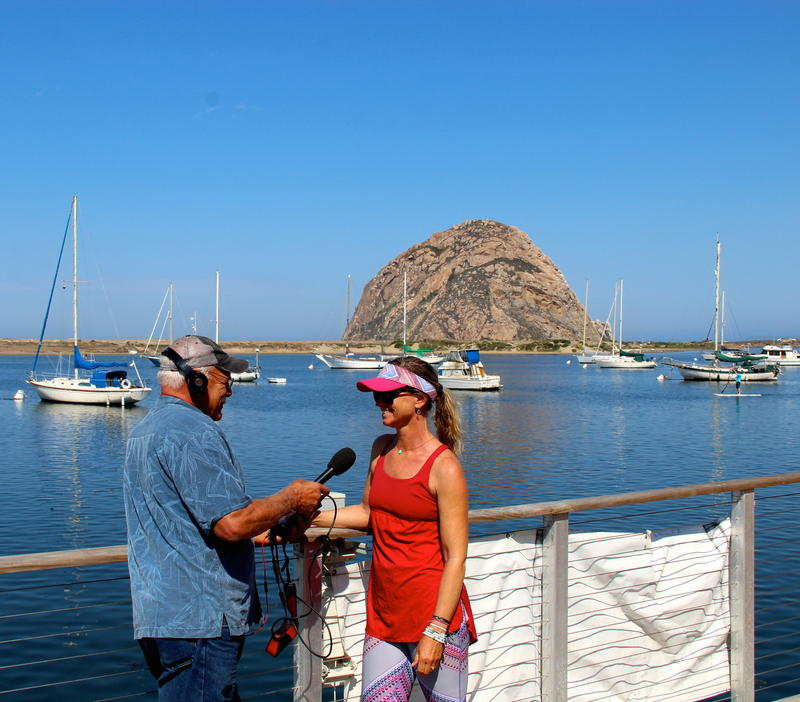 Sandi Twist talks SUP with correspondent Tom Wilmer on the docks in Morro Bay, California