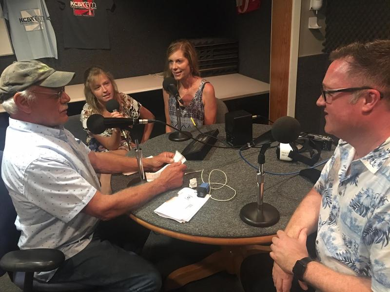 Host Tom Wilmer visits with Cal Poly Intern Randy Hair (Left) Virginia Scripps (Center) and Kain Tietzel, CEO of StartVR (Right) in the KCBX NPR affiliate studio in San Luis Obispo, California