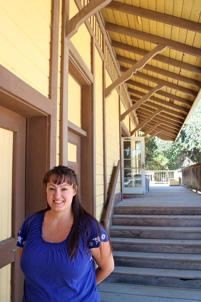 Jessica Potts, Executive Director of the Agricultural & Rural Life Museum at San Lorenzo County Park in King City, California in front of the old (circa-1903) King City train station--that was relocated to the park