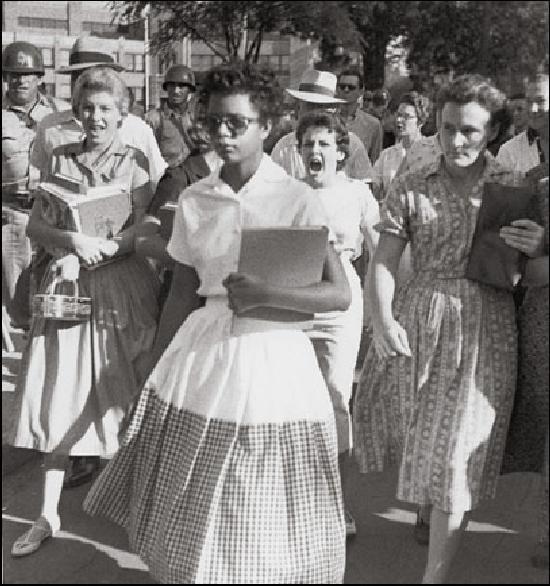 Elizabeth Eckford runs a gauntlet of hate to attend high school in Little Rock. The young white woman just over her shoulder with her mouth open, yelling at her is Hazel Bryan-- Arkansas September 1957
