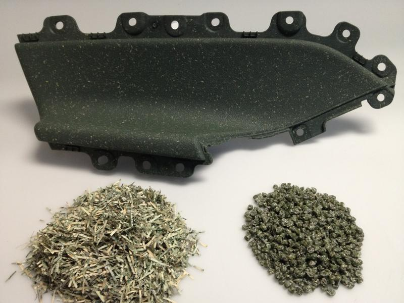 Ford armrest made with recycled U.S. Currency and pellets