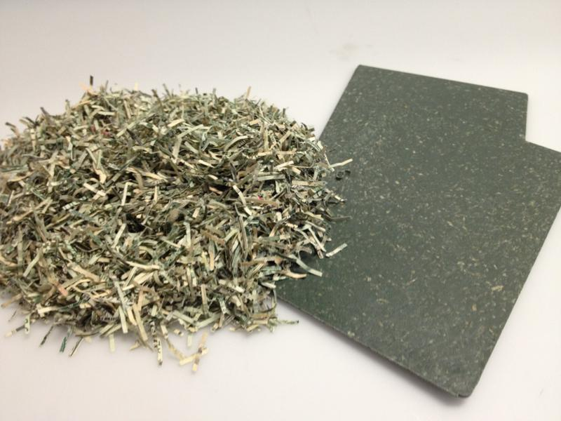 shredded U.S. currency repurposed for use in composit parts for Ford vehicles
