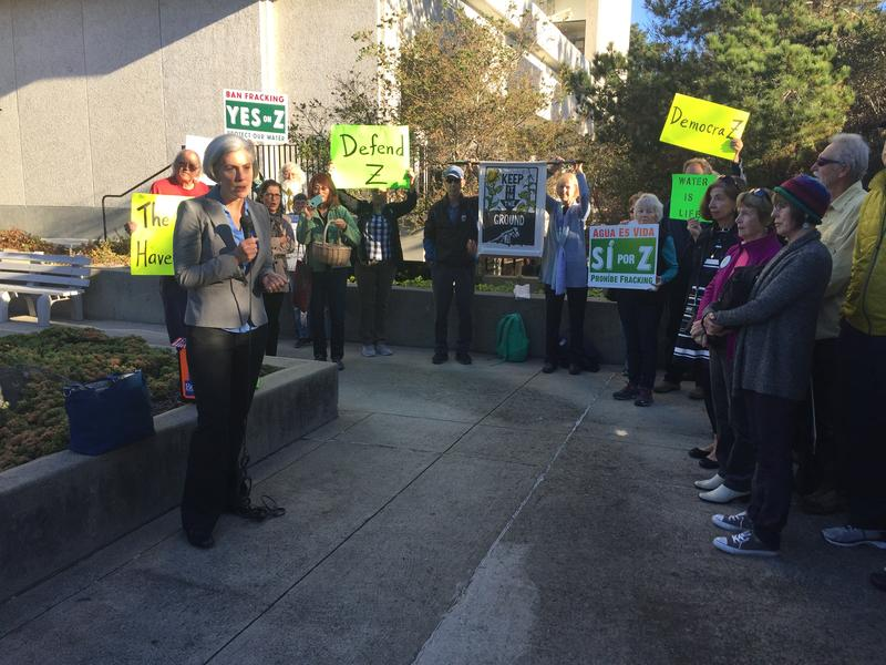 Kassie Segal with the Center for Biological Diversity addresses Measure Z supporters before the trial started on Monday morning.