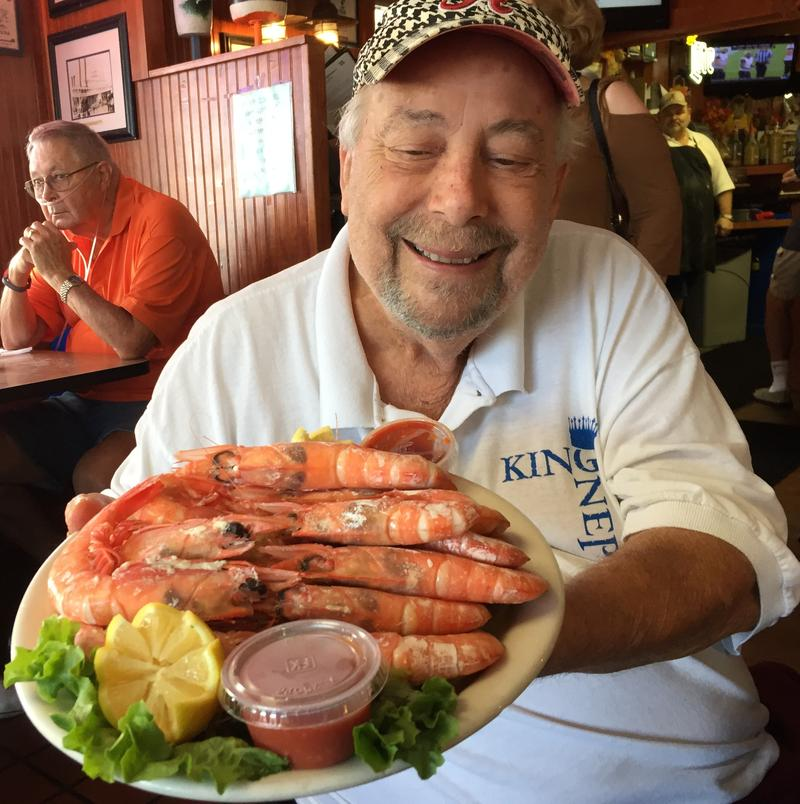 Al Sawyer shows off platter of Royal Red shrimp at King Neptune's Seafood Restaurant in Gulf Shores, Alabama