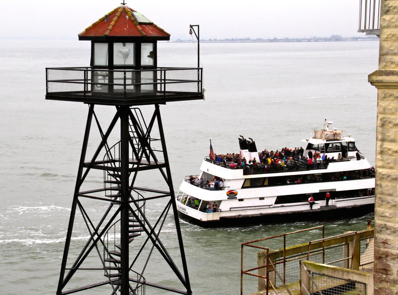 "Alcatraz Watch Tower with Alcatraz Cruises vessel touring around the ""Rock"""