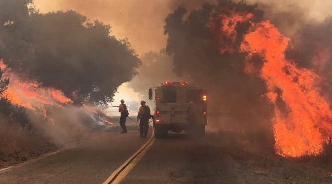 Firefighters battling the Mesa Fire along Foxen Canyon Road in July, 2017.