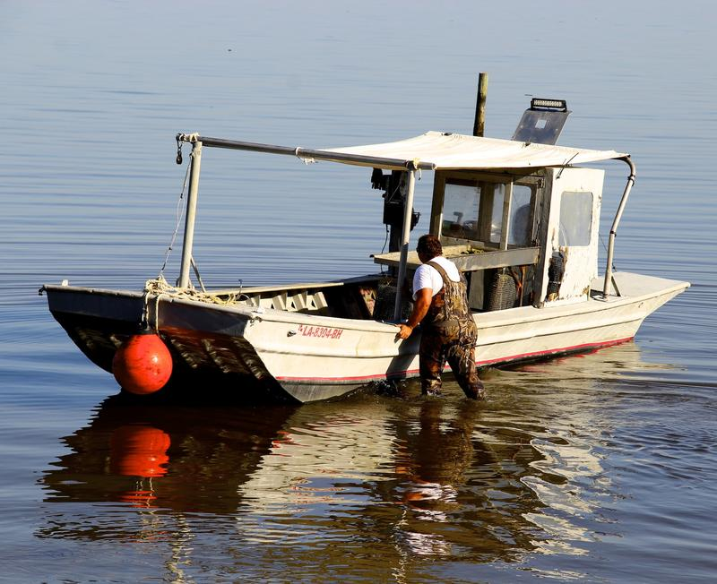 Jarrett Daniel Frith tends his oyster boat, Fort Morgan, Alabama