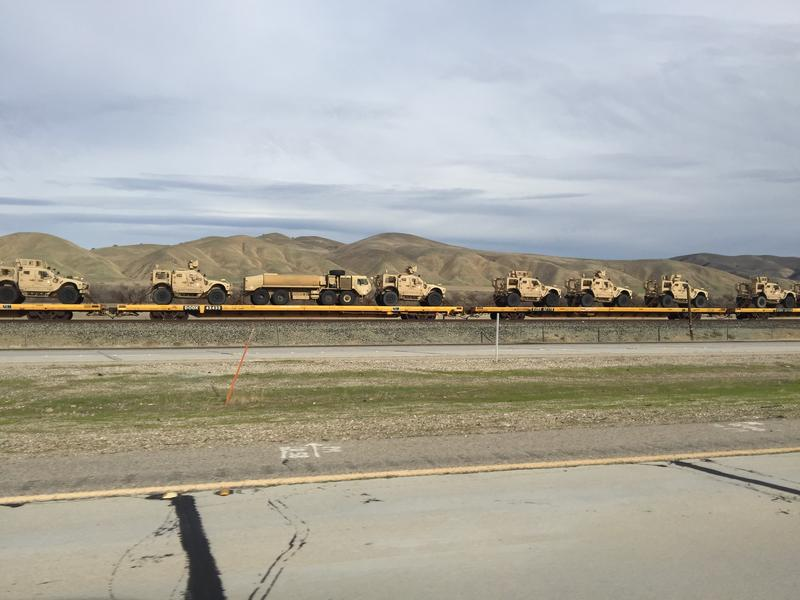 Military vehicles on rail platforms adjacent to Camp Roberts on Jan. 15, 2018.
