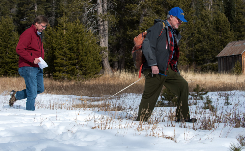 Grant Davis, Director of the California Department of Water Resources, left, assists Frank Gehrke, Chief of the Calif. Cooperative Snow Surveys Program, with the first snow survey of the 2018 season at Phillips Station in the Sierra Nevada Mountains.