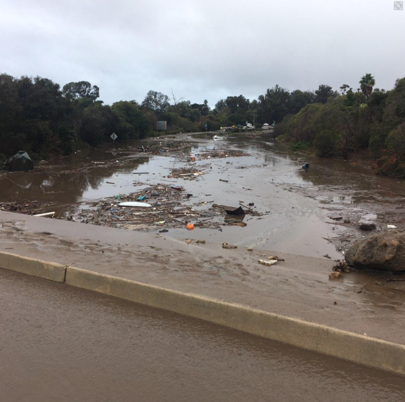 Highway 101 between Hot Springs Road and Sheffield Drive is now covered in water, mud and debris.
