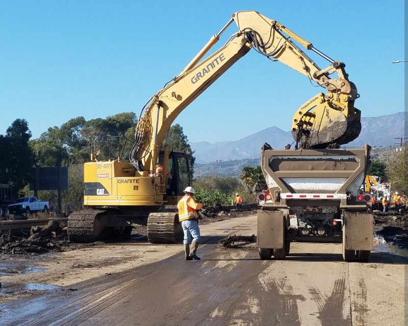 Caltrans crews work to clean up the debris from Tuesday's slides.