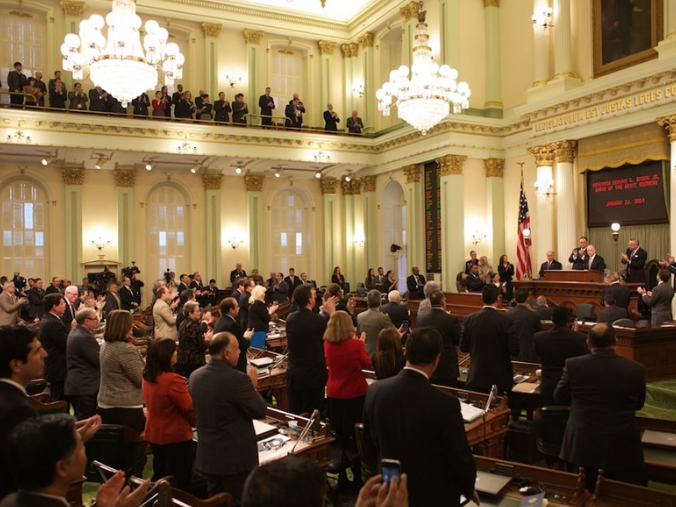 Lawmakers applaud Jerry Brown at the state capitol Thursday.