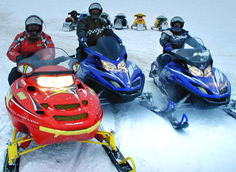 Snowmobile racing on Lake Michigan is popular winter pastime in St. Ignace, Michigan