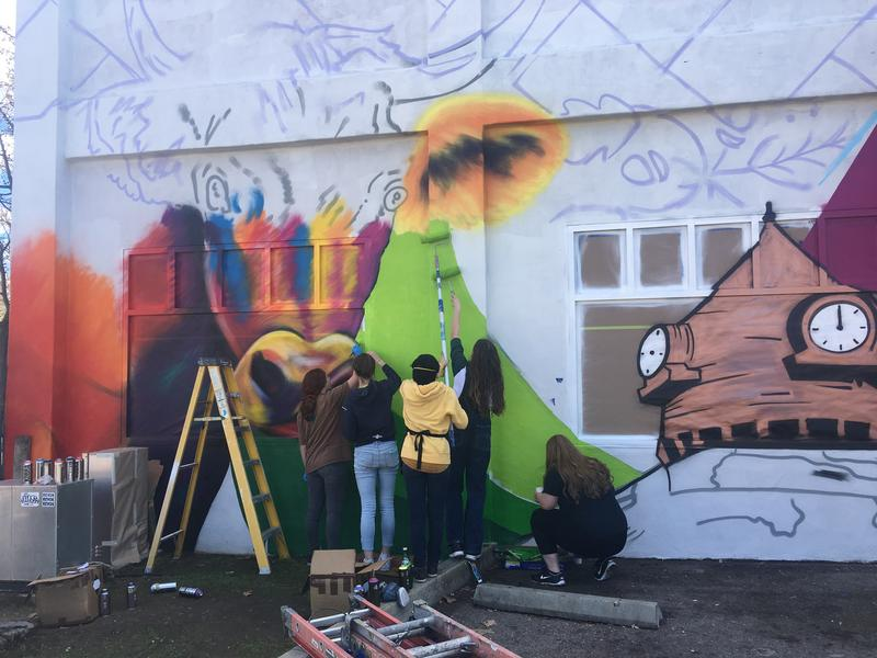 Painting the new mural at 12th and Spring Streets.