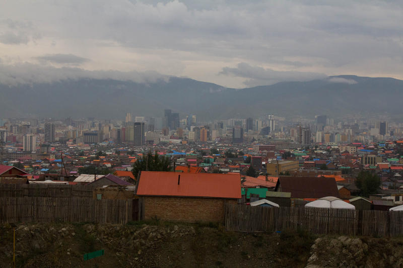 A view of Ulaanbaatar, Mongolia and the ger areas that surround it. When newcomers migrate to the capital they often bring their traditional tents or gers with them.