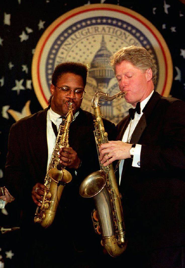 Jim Ed Brown playing sax with President Bill Clinton