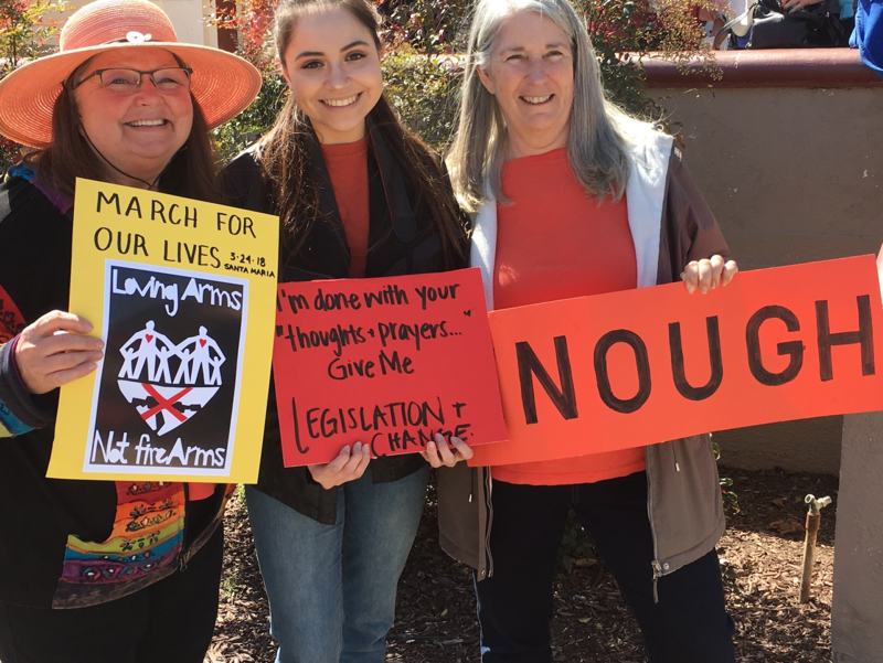 Community members show off their signs at the March for Our Lives protest in Santa Maria.