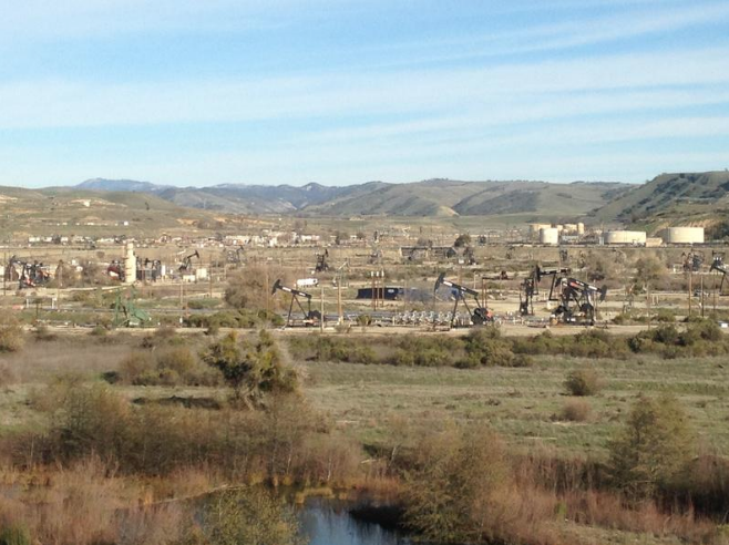 Pumpjacks at the San Ardo oil field, with the Salinas River in the foreground.