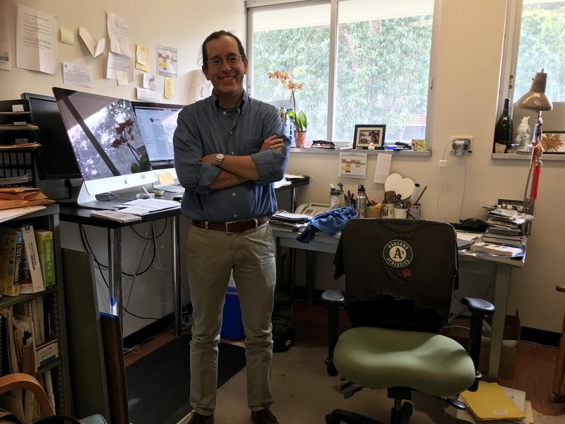 Dr. Neal MacDougall in his office at Cal Poly.