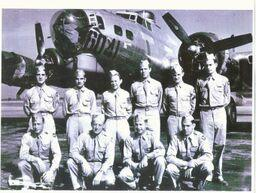 "Ball turret gunner Donal Laird of San Luis Obispo, top row, third from left, was killed on his first mission in the B-17 in the background, ""Strictly G.I."" A German group devoted to identifying missing and lost fliers returned Laird's wristwatch t"