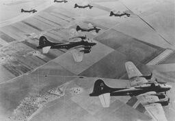 The B-17 at the bottom of this photo, on a mission to Anzio, Italy, was piloted by Harold Schuchardt of Los Osos when it was shot down over Hungary. Schuchardt was captured and served out his war as a POW. Courtesy the American Air Museum