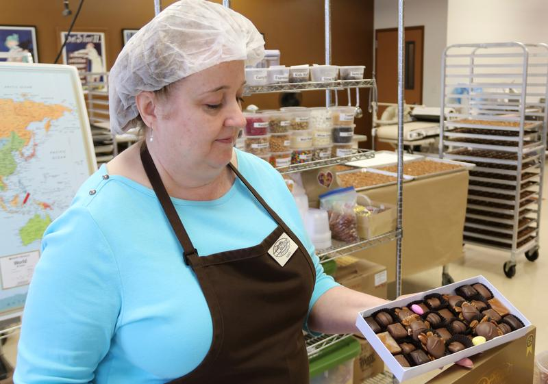 Mary shows off a fresh batch of delectable Wilmar Chocolates in Appleton, Wisconsin.