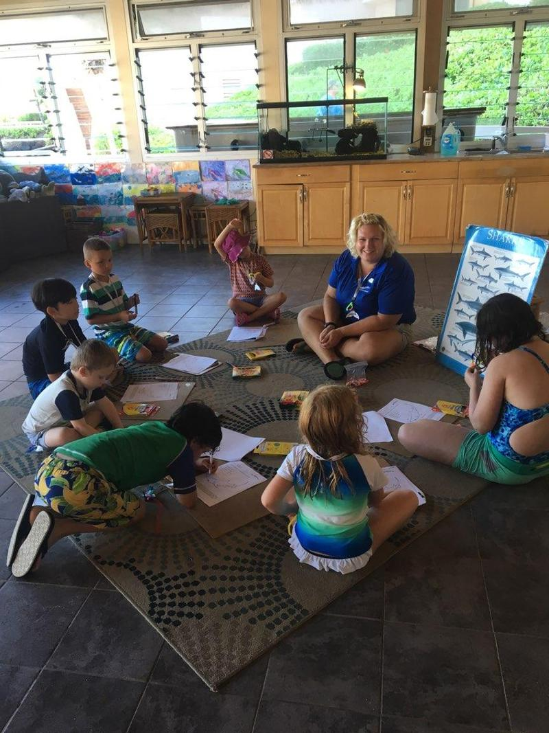 Jackie Milligan teaching kids about marine life at Dolphin Quest