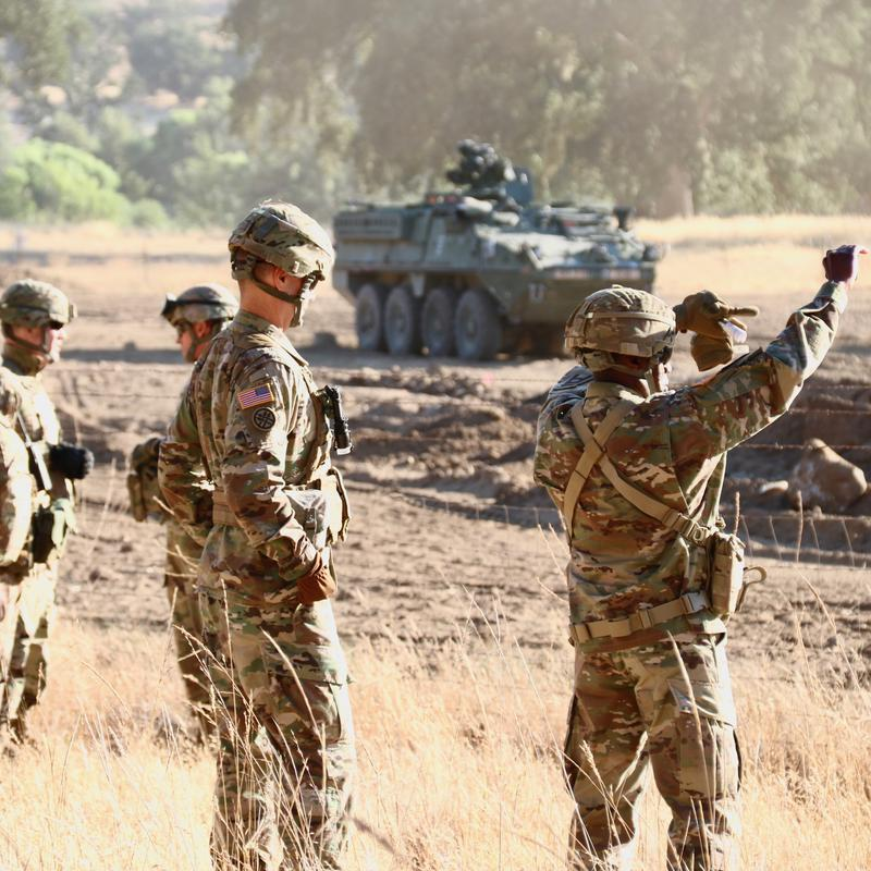 Army Reserve troops observing field exercises at Fort Hunter Liggett.