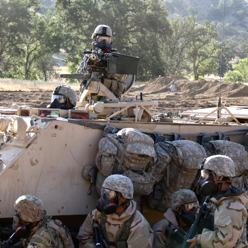 Amry Reserve troops seak protective cover during Combat-Ready field exercise at Fort Hunter Liggett