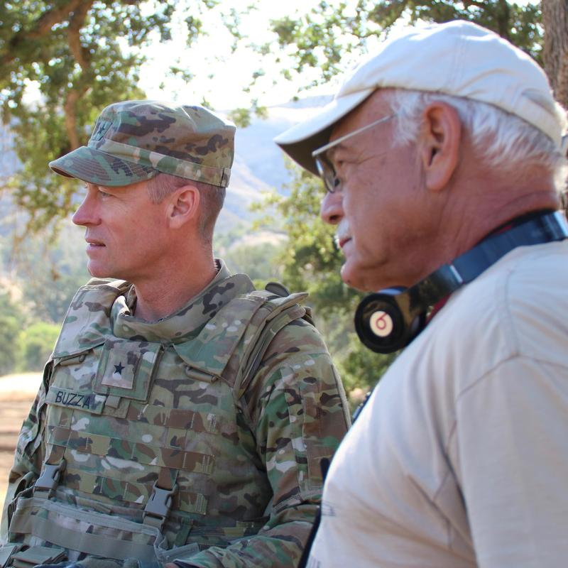 Brigadier General Shane Buzza, Commanding General of the 91st Training Division at Fort Hunter Liggett and correspondent Tom Wilmer (right) observe Army Reserve training exercise