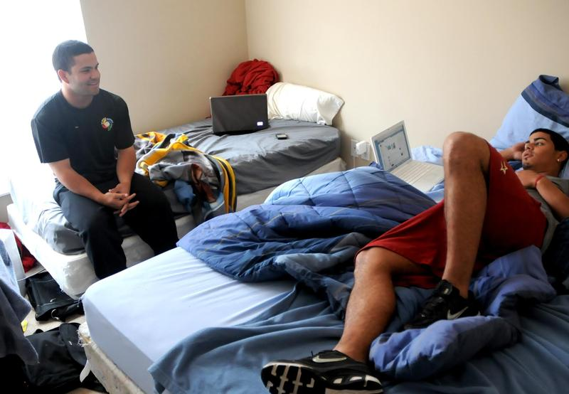 Lexington Legends teamates, Jose Altuve and Jiovanni Mier, relax in their apartment.