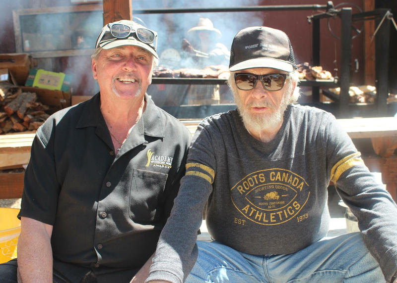 Chris Christensen (Left) with musician Merle Haggard