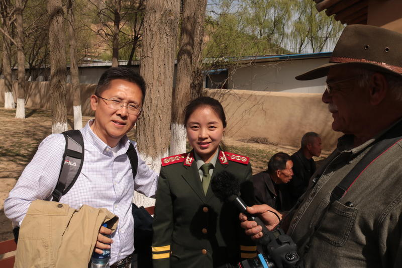 Paul Su (left) poses with guide at Mao's headquarters.