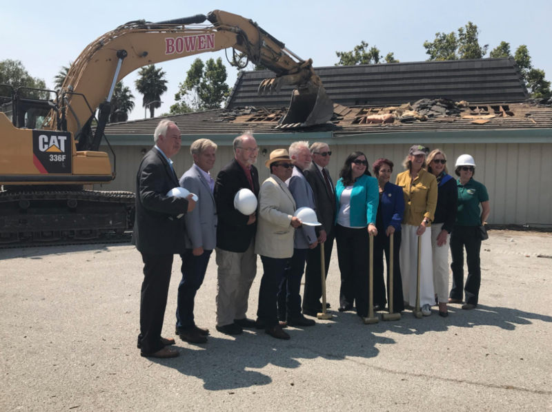 Part of the project also includes a major renovation for the Salinas train station. Some of the many people involved in the project pose in front of the first old building that's getting demolished.