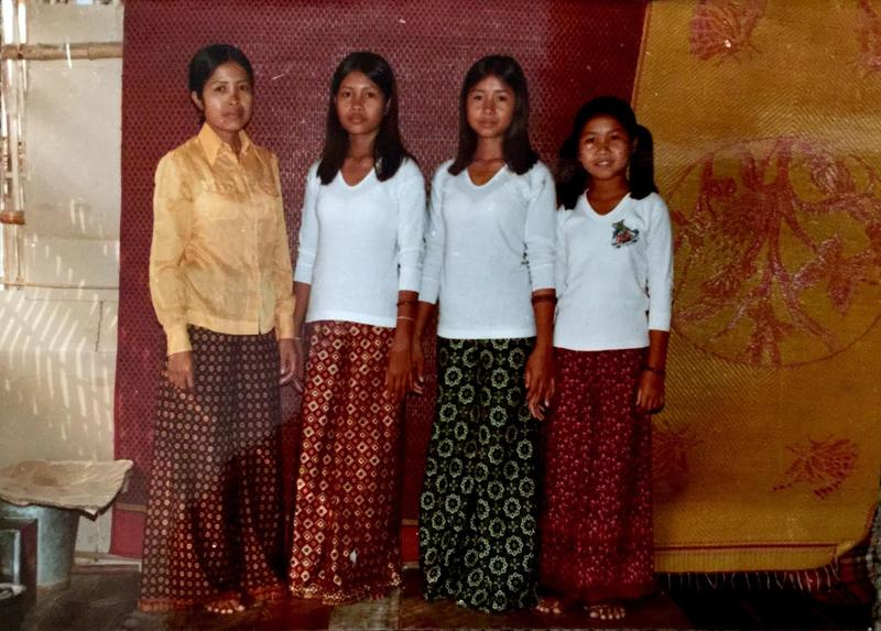 San Croucher, left and her daughters Sithy, Sithea and Jennifer at a refugee camp in Thailand.