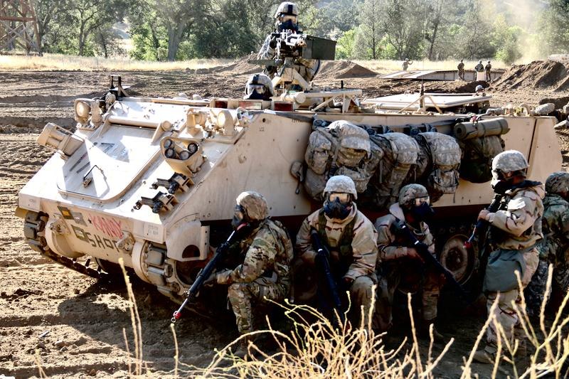 Combat troops practice a chemical attack training exercise at Fort Hunter Liggett.