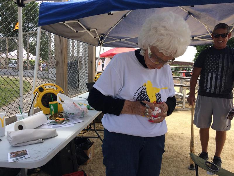 Maybelle Blair signs baseballs now instead of throwing them.